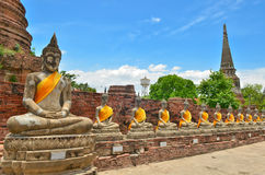 Ancient buddha statues with blue sky Stock Image