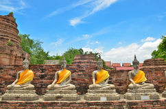 Ancient buddha statues with blue sky Stock Photography