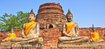 Ancient Buddha statues in front of pagoda. Ancient Buddha statues in meditation position at the temple Stock Images