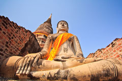 Ancient Buddha statues in front of pagoda Stock Image