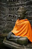 Ancient Buddha statues in orange cover Royalty Free Stock Image