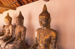 Ancient buddha statues in Wat Phra Borommathat Chaiya Ratchaworawihan temple Royalty Free Stock Photo