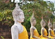 Ancient Buddha statues at Wat Yai Chai Mongkol, Ayutthaya, Thail Stock Images