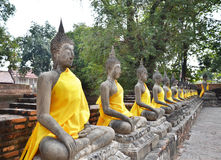 Ancient Buddha statues at Wat Yai Chai Mongkol, Ayutthaya, Thail Stock Photos