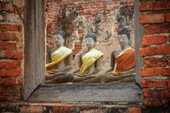 Ancient  buddha statues through window Stock Image