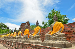 Ancient Buddha Statues With Blue Sky In Thailand Stock Photos