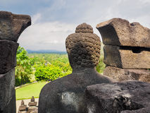 Ancient Buddha stature in Indonesia. The Buddha statute at  Borobudur temple, Magelang Regency, near Yogyakarta, Java Island, Indonesia Royalty Free Stock Image