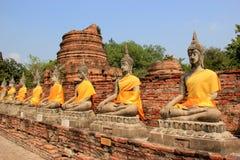Ancient Buddha at Watyaichaimongkol Temple in Ayudhaya, Thailand. Ancient Buddha and Pagoda at Watyaichaimongkol Temple in Ayudhaya, Thailand Royalty Free Stock Image