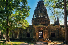 Ancient buddhist khmer temple in Angkor Wat complex. Cambodia. people are not identifiable Stock Photography