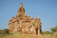 Ancient Buddhist pagoda close up on a sunny day. Bagan, Myanmar Stock Image