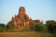 Ancient Buddhist pagoda Tha Kya Pone in the light of the morning sun. Bagan, Myanmar Royalty Free Stock Photography