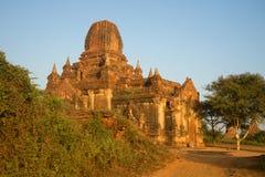 Ancient Buddhist pagoda Tha Kya Pone in rising sun closeup. Old Bagan, Myanmar Royalty Free Stock Photography