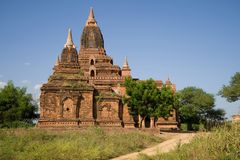 Ancient Buddhist pagoda Tha Kya Pone is a sunny day. Bagan, Myanmar Stock Image