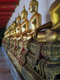Ancient buddhist statues in old temple. Ancient buddhist statues in Wat Po in Bangkok Stock Photography