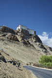 Ancient Buddhist temple on cliff over the road Stock Images