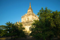The ancient Buddhist temple of Gawdaw-palin in beams setting the sun. Bagan, Burma Royalty Free Stock Photos