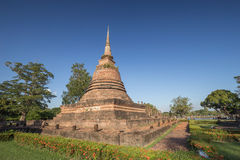 Ancient buddhist temple ruins in Sukhothai historical park Stock Photos