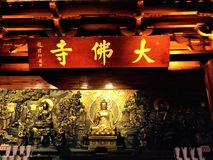 An ancient buddhist temple, a statue of a god on the wall stock photo