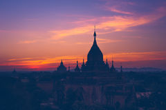 Ancient Buddhist Temples of Bagan Kingdom at sunrise. Myanmar (B Stock Photography
