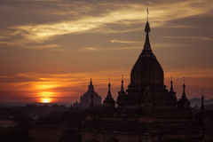 Ancient Buddhist Temples of Bagan Kingdom at sunrise. Myanmar (B Stock Images
