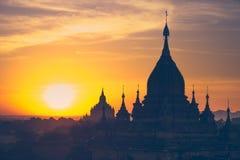Ancient Buddhist Temples of Bagan Kingdom at sunrise. Myanmar (B Stock Image