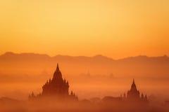 Ancient Buddhist Temples of Bagan Kingdom at sunrise. Myanmar (B Stock Photo