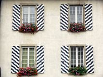 Windows with striped decorated shutters stock photo