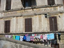Ancient building of the district Garbatella in Rome with some suspended laundry that`s drying up. Rome Italy. stock photos