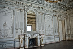 The ancient building.The interior of the white hall with stucco. Stock Image