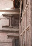 Ancient building of nepal with bricks and wooden windows royalty free stock photo