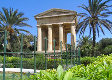 Ancient building in the park of Valetta Stock Images