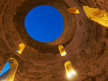 Ancient building roof with circle dormer and opening hole. Stock Photos