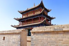An ancient building viewed from the other side of a wall. Of Jiayu Pass Jiyuguan, the first frontier fortress at the west end of the Great Wall of China stock photography