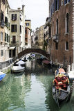 Ancient buildings and boats in the channel in Venice Stock Image