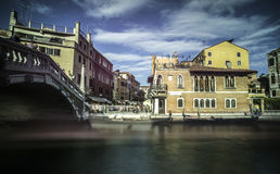 Ancient buildings and boats in the channel in Venice Royalty Free Stock Photo