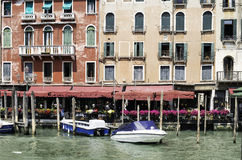 Ancient buildings and boats in the channel in Venice Royalty Free Stock Image