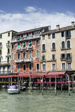 Ancient buildings and boats in the channel in Venice Stock Photo