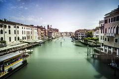 Ancient buildings and boats in the channel in Venice Royalty Free Stock Images
