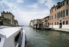Ancient buildings and boats in the channel in Venice Stock Photos