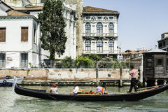 Ancient buildings and boats in the channel in Venice. Stock Photo