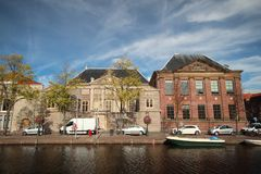 Ancient buildings with canals in the inner city of the town Leiden in the Netherlands.  stock photos