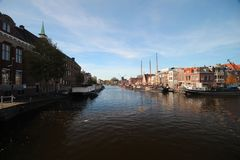 Ancient buildings with canals in the inner city of the town Leiden in the Netherlands.  royalty free stock photos