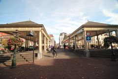 Ancient buildings with canals in the inner city of the town Leiden in the Netherlands.  stock photo