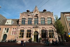 Ancient buildings with canals in the inner city of the town Leiden in the Netherlands.  royalty free stock photo