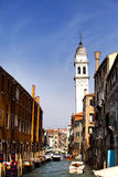 Ancient buildings on coast of the narrow channel. Venice, Italy. Royalty Free Stock Photos