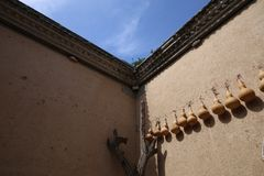 Ornaments of ladle and pepper hang in the sunken courtyard Stock Image