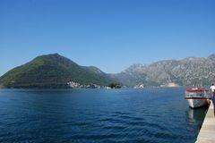 Little fiord of Kotor in Montenegro. Ancient buildings and historical walls of biggest fiord in Afriatic sea, Kotor royalty free stock photos