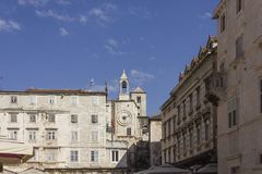 Ancient buildings in Narodni square in Split, with its famous tower clock. SPLIT, CROATIA - AUGUST 11 2017: Architectural view of ancient buildings in Narodni Royalty Free Stock Photos
