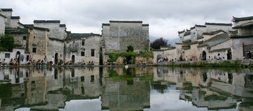 Ancient buildings with reflection in the pond Stock Images