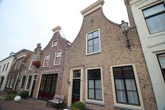 Ancient buildings on the streets of city Haastrecht in the Netherlands in the Krimpenerwaard area. Ancient buildings on the streets of city Haastrecht in the royalty free stock images